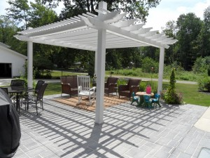 white pergula, stenciled concrete patio