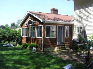 four seasons addition with cedar shake siding