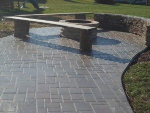Stenciled concete patio with fire pit